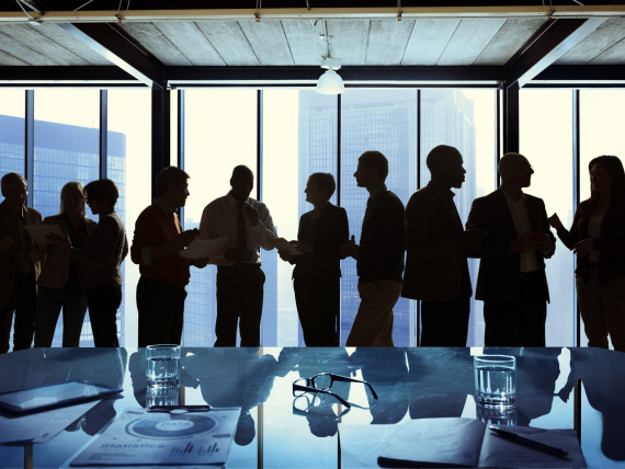 Group of Business Talking in a Meeting